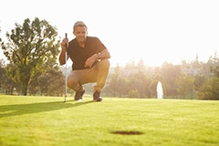 image of a man looking down the putting green for the best possible shot