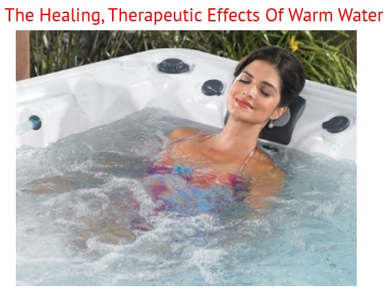 a woman relaxes in a caldera hot tub